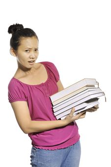 Free College Student Carrying Stack Of Books Royalty Free Stock Images - 27337529