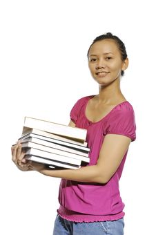 Free College Student Carrying Stack Of Books Royalty Free Stock Photography - 27337537