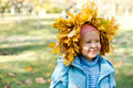 Free Small Girl In A Crown Of Autumn Leaves Stock Photos - 27359643