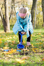 Free Little Girl Digging In The Park Royalty Free Stock Image - 27359696