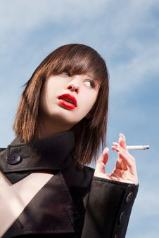 Free Elegant Girl With A Cigarette Royalty Free Stock Image - 27358176