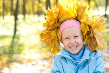 Free Laughing Child Wearing Yellow Autumn Leaves Stock Images - 27359644