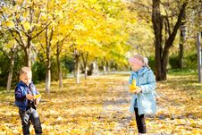 Children In A Colourful Autumn Park Royalty Free Stock Photography