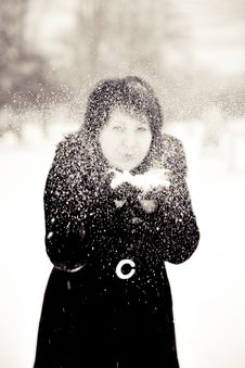 Girl And Snow Royalty Free Stock Images