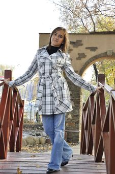 Girl On A Bridge Royalty Free Stock Photos