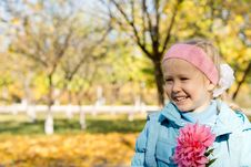 Free Smiling Little Girl With Pink Dahlia Stock Image - 27369021