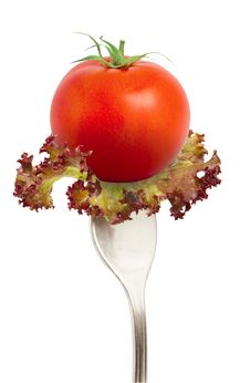 The Fresh Tomato On Fork Stock Photography