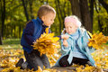 Free Young Children Gathering Leaves In Autumn Splendor Stock Images - 27373694