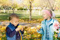 Free Little Boy And Girl Eating Apples Stock Photography - 27377072