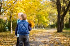 Free Young Boy And Girl With Yellow Autumn Leaves Stock Image - 27373651