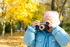 Small Girl Taking A Photograph Stock Image