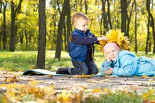 Free Little Boy Making An Autumn Hat For His Sister Royalty Free Stock Image - 27376746