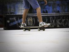 Free Skateboarders Feet While Skating On Concrete Royalty Free Stock Image - 27384316