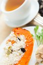 Free Baked Pumpkin With Rice And Raisins And Cup Of Tea Royalty Free Stock Photo - 27398885