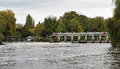 Free Weir And Sluice Gate On A Swollen River Thames Royalty Free Stock Images - 27399319