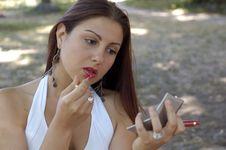Free Woman Applying Lipstick Stock Photography - 2746272