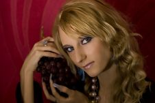 Blond Girl With Grapes Royalty Free Stock Photography