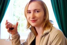Blonde Girl Drinking Wine Royalty Free Stock Photo