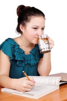 Free Pretty Schoolgirl Drinking Tea Stock Image - 27404861