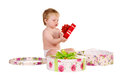 Free Boy Plays With Gift Boxes Stock Photos - 27413743