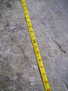 Free Construction Measuring Tape On Grunge Concrete Stock Photo - 27419410