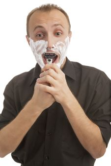 Free Portrait Of A Male Trying To Shave Against White Stock Images - 27414114