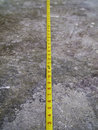 Free Measuring Tape On Concrete Floo Stock Photography - 27420052