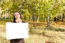 Woman In The Countryside Holding A Card Royalty Free Stock Photos