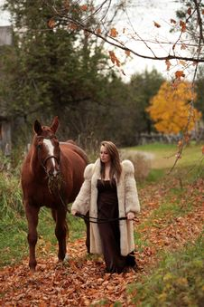 Free Formal Young Lady Walking Her Horse Royalty Free Stock Images - 27428269