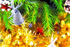 Free Silver Bell On The Branch Of A Christmas Tree Royalty Free Stock Photo - 27429665