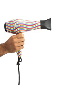Free Hand Holding A Design Hair Dryer Stock Image - 27434651