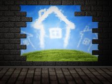 Cloud Houses In Hole In Brick Wall Royalty Free Stock Image