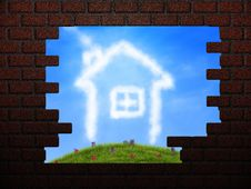 Cloud House In Hole In Brick Wall Royalty Free Stock Photos