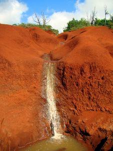 Red Sandstone Rocks And Waterfall In Waimea Canyon Stock Photo