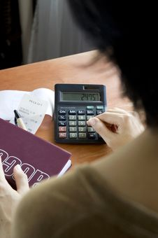 Free Woman With A Calculator Stock Images - 27452784