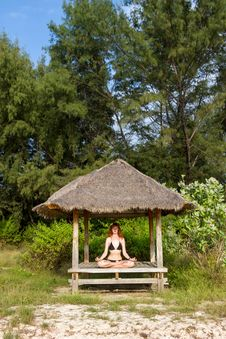 Woman Doing Yoga Meditation In Tropical Gazebo Stock Photos