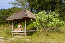 Woman Doing Yoga Meditation In Tropical Gazebo Stock Photography