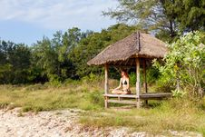 Woman Doing Yoga Meditation In Tropical Gazebo Stock Images