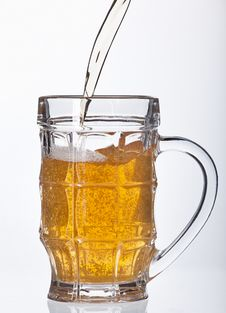 Free Beer Pouring Into Beer Mug Stock Photo - 27469070