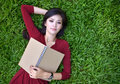 Free Woman Lying On Grass With  Book Stock Photo - 27473460