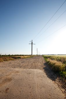 Rural Road And The Blue Sky Royalty Free Stock Photos
