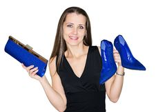 Woman Chooses  Clutch  Bag And Shoes Stock Photo