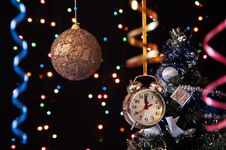 Free Ball,clock,serpentine, Decorated  Tree On A Black Royalty Free Stock Photography - 27489747
