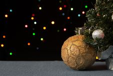 Free Golden Ball Under A Decorated Christmas Tree Stock Image - 27489761