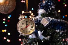 Free Clock ,a Decorated Christmas Tree On A Black Stock Photo - 27489800