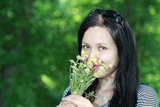 Free Brunette Smelling Flowers Royalty Free Stock Photos - 27490178