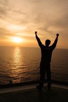 Silhouette Image Of Man Raising His Hands Stock Photography