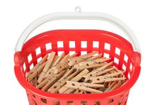Free Set Of Clothespins In The Red Basket. Stock Images - 27497994