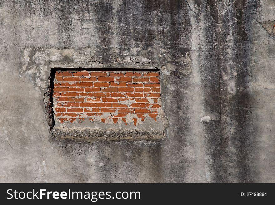 Window blocked by brick wall