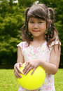 Free Girl Holding Yellow Ball Royalty Free Stock Photos - 2755528